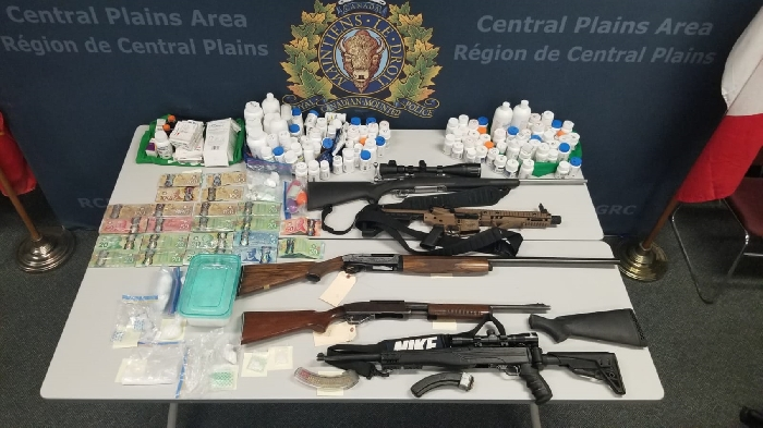 Firearms, pellet gun, ammunition, Canadian currency, cannabis, cocaine, methamphetamine and other substances that were seized by the police.