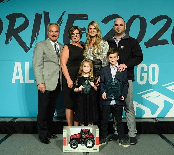 Kristjan Hebert has been named the 2020 winner of Farm Journal's annual Top Producer of the Year award. He celebrates with his family in Chicago.  In back, from left, are Louis, Karen, Theresa, and Kristjan Hebert. In front are children Ivy and Bentley