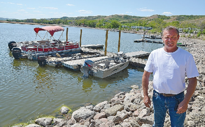 Willie Kuzub in front of the new marina he has developed at his West End Resort on Round Lake.