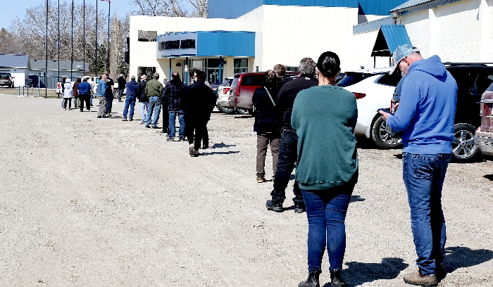 Dozens lined up outside the Moosomin Communiplex to receive a dose of the AstraZenica COVID-19 vaccine on Wednesday, April 21.