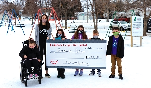 Borderland Co-op donates $8,235 to Rocanville School wheelchair swing project